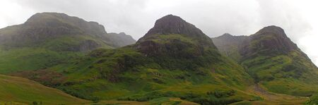 typically scottish: highlands valley of scotland with mountains Stock Photo