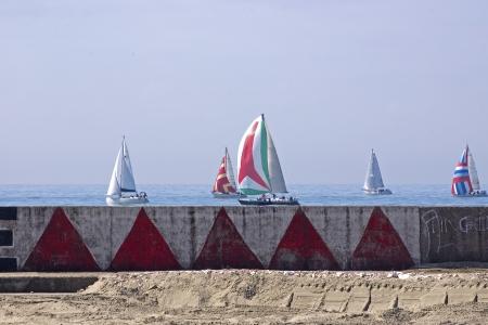 regatta sailing near the sea port in Viareggio Italy