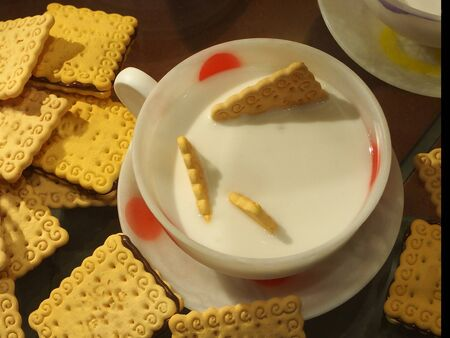 inviting, fresh breakfast with milk and golden cookies