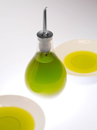glass jar of Italy green olive oil of  white background Stock Photo