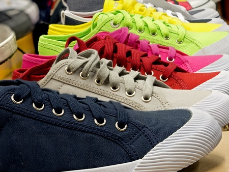colored sports shoes made of rubber and canvas Stock Photo