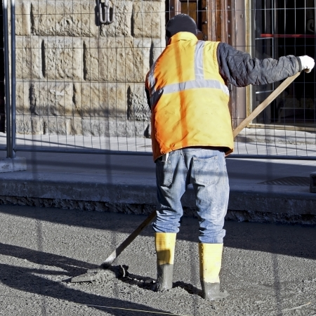 worker man with the shovel working in the sun Stock Photo