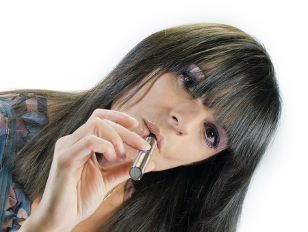 brunette beautiful girl smoking electronic cigarette Stock Photo - 20638589