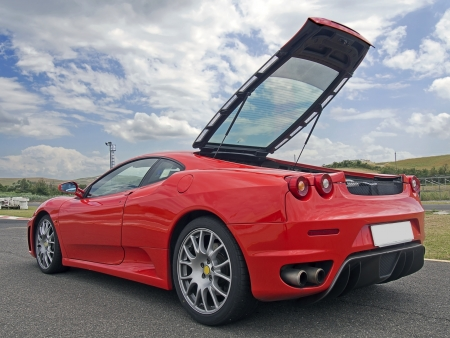 red beautiful ferrari f430 with tailgate open Editorial