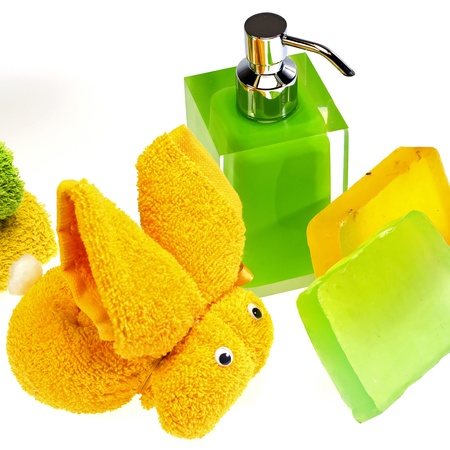 wash skin with colored soap dispenser and towels
