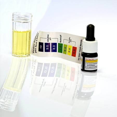 Acid acidic water test with ph reagent Stock Photo