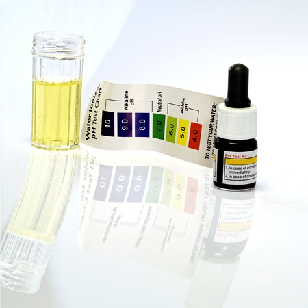 ph: Acid acidic water test with ph reagent Stock Photo