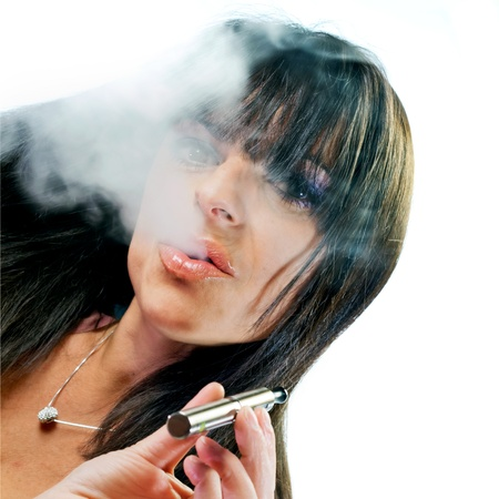 electronic background: brunette beautiful girl smoking electronic cigarette