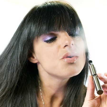 brunette beautiful girl smoking electronic cigarette photo