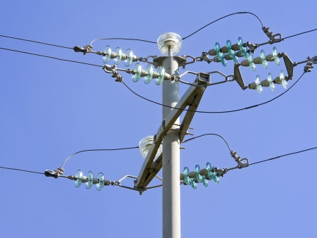 Current pole with insulators, blue sky