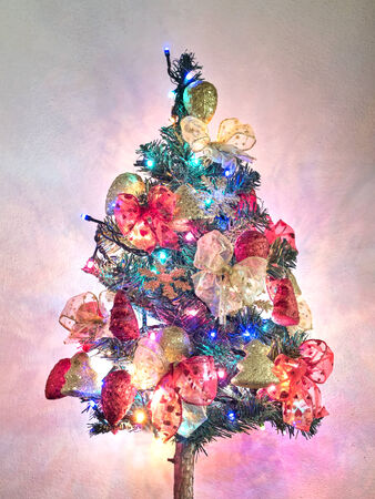 Christmas tree with decorations and lights on
