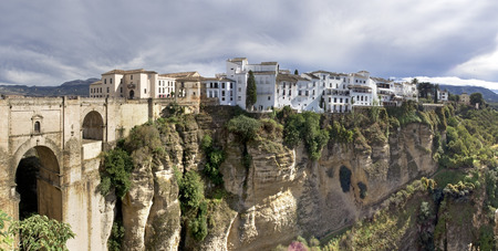 Ronda Village  suspension bridge, white houses perched on the rocks panoramic view