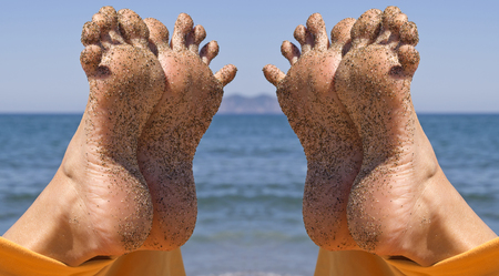 sandy crazy woman toes  moving and relaxing on the beach Stock Photo