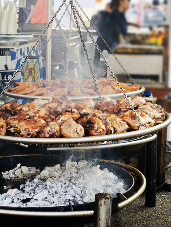 roasted pork knuckle  on  large brazier in country fair