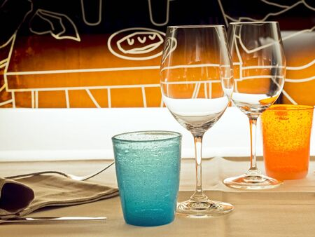 glasses and colored glasses in a bistro for a romantic date