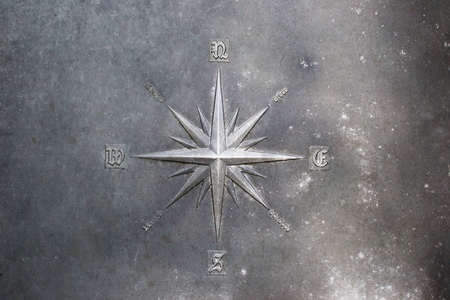 The wind rose,Compass rose engraved on the metal Stock Photo
