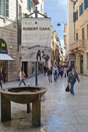 april 26 2012 Verona, Italy Via Mazzini poster advertising an exhibition of Robert Capa