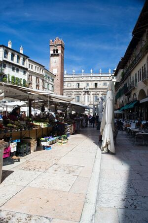april 26 2012 Verona, Italy Piazza Herb Market day view of the tower and view of the palace maffei People at the market square of grass Stock Photo - 13387301
