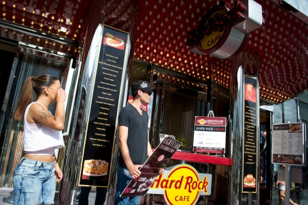 las vegas,nevada,USA-August 13,2012 las vegas city on day time Boys attract customers in the famous hard rock cafe for  drink and relax