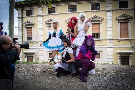 eventful: lucca,italy-november 3,2012 a group of people dressed as fantasy characters of the novel  Alice in wonderland  pose for photographer in lucca fair
