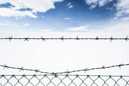barbed wire on the background of snowy landscape Stock Photo