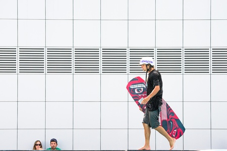 bologna,Italy-June 15,2013 two guys watching a guy with\ wakeboard out of the pool of the race during a sporting event in\ Italy\