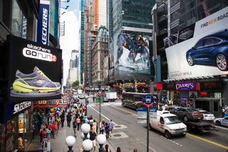 New York City, USA - August 2, 2013 time square in the daylight is full of advertising signs,billboard, traffic and people walking by shopping or sightseeing