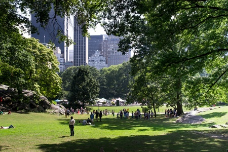 New York City, USA - August 3, 2013 new york skyline seen from Central Park, where large numbers of people is to do sports and relax in nature