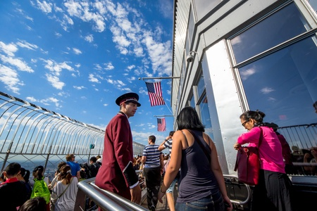 aereal: New York City, USA - August 4,2013 Empire State Building staff supervises and advises tourists who climb to the top to see the view on new york
