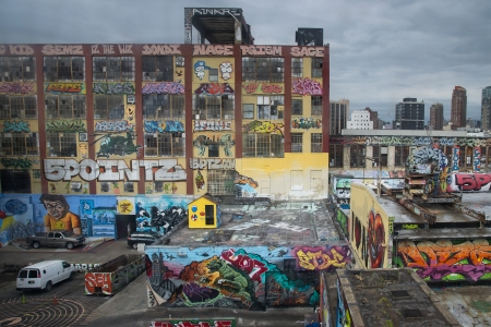 buildings covered with graffiti in the area of Queens in New York City