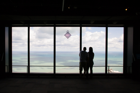 john hancock: Chicago,USA-august 13,2013 a couple observes the view to the east of the john hancock center in chicago