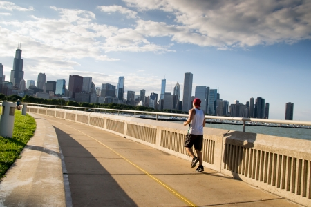 Chicago,USA-august 13,2013 many athletes practice running and biking on the number of bike lanes Chicago at sunset