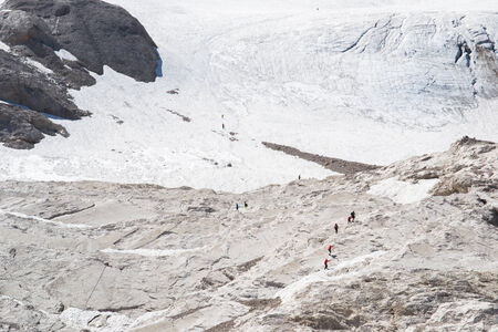 people walking on the Marmolada and admire the scenery