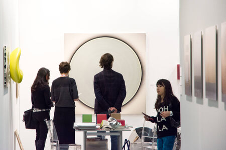 Bologna,Italy-january 25,2014 people walk and look at works of art in an exhibition in bologna