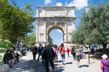 rome,italy-April 17,2014 a large number of tourists visiting the imposing Arch of Titus located in the Roman Forum in Rome during a sunny day