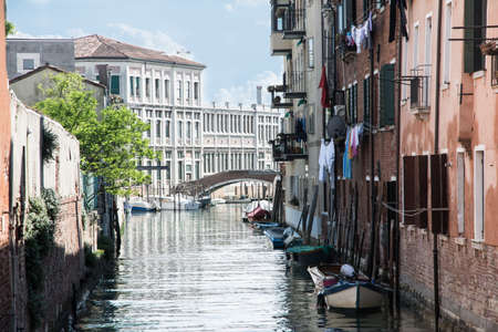 venice,italy-may 1,2014 landscape of the more Venetian canal with his boats and houses durind a sunny day