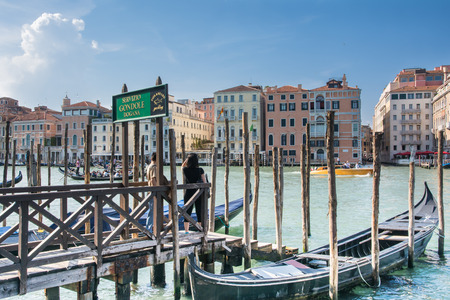 Venice,Italy- May 1,2014 - tourists waiting to get on a gondola in the famous Grand Canal of Venice during a sunny day