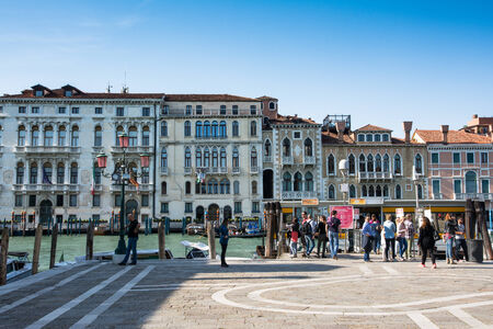Venice,Italy- May 1,2014 - Tourist stroll near the grand canal in Venice with his boats and houses during a sunny day