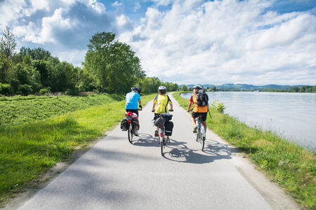 Wachau Valley,Austria-May 9,2014 People are riding bcycle at cycle path near danube river in Austria during a sunny day Editorial