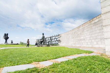 perpetrator: Mauthausen, Austria - May 10,2014 people admire one of the more monument before entering the camp during a cloudy day