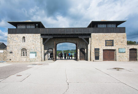concentration camp: mauthausen, Austria - May 10,2014 people entering the concentration camp of Mauthausen from the main entrance during a cloudy day