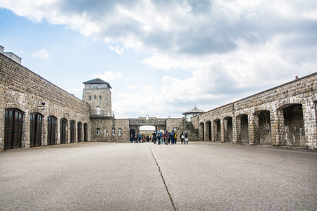 perpetrator: mauthausen, Austria - May 10,2014 people entering the concentration camp of Mauthausen from the main entrance during a cloudy day