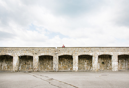 mauthausen, Austria - May 10,2014 man over the wall inside the mauthausen camp in Austria during a cloudy day