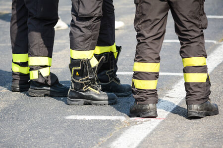 oversee: bologna,Italy-June 7,2014:three firefighters oversee the situation during the course of a sporting event in bologna in a sunny day