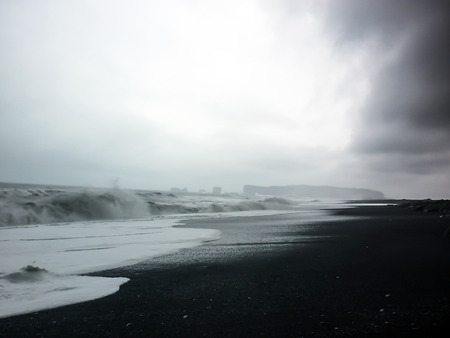 black beach of Vik and rock in iceland Banco de Imagens