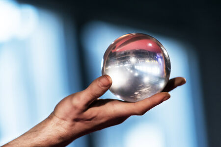 sensory perception: Padova,Italy-December 8,2014:A tightrope artist plays with a crystal ball during an event called Festival of East which takes place in the Italian city of Padua