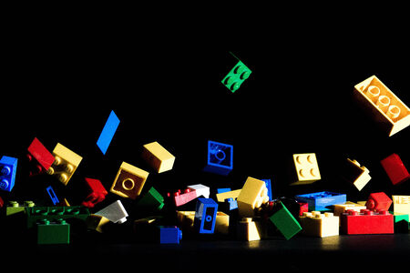 colorful building blocks jumping on a dark background
