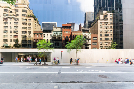 new York City, USA - August 2, 2013:People stop in front of the entrance to the Moma, the famous museum of modern art in New York during a sunny day. Editorial
