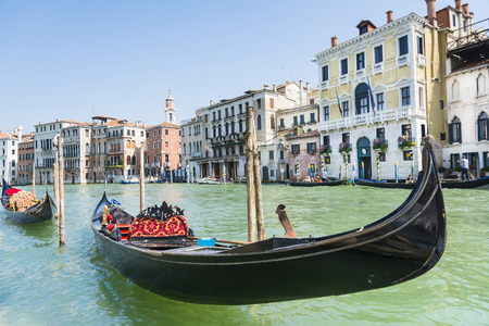 Venice, Italy-August 12.2014: Traditional venetian gondola await some tourists to carry around on a gondola in Venice During a sunny day.