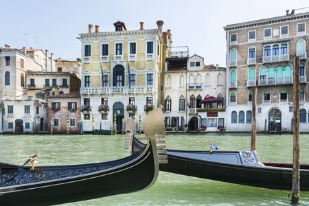 await: Venice, Italy-August 12.2014: Traditional venetian gondola await some tourists to carry around on a gondola in Venice During a sunny day.